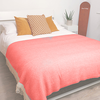 The Coral Herringbone 100% Wool Blanket, available from Robeys in Derbyshire